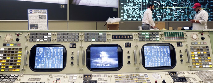 To recreate the scene as it was, some of the restored control panels have half-filled coffee cups, binders, and eyeglasses beside them.