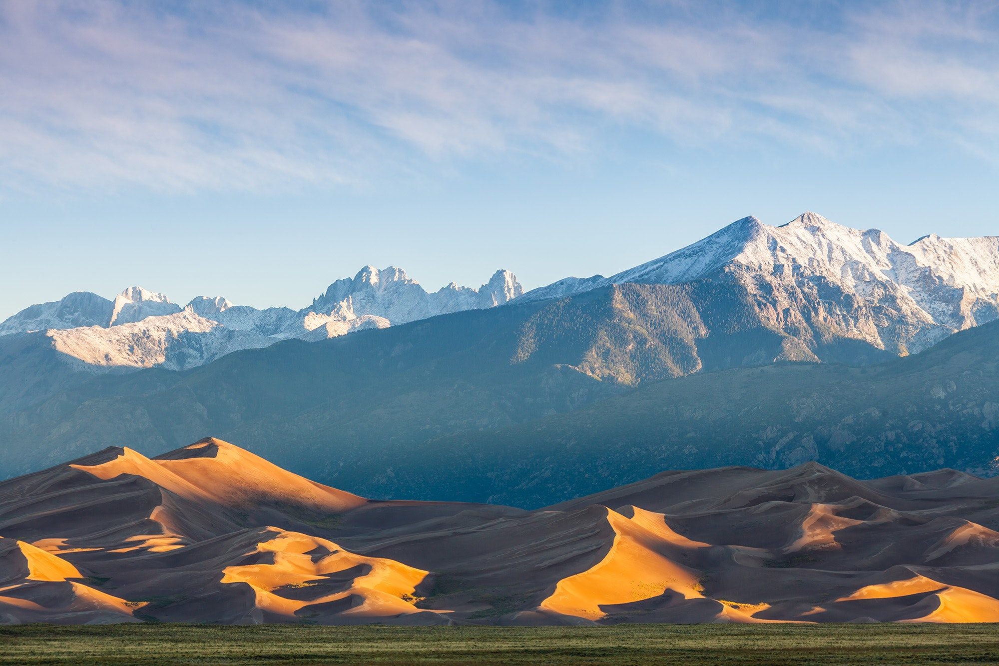 A surprising site in the mountains of Colorado, Great Sand Dunes National Park and Preserve looks like a mini Sahara Desert.