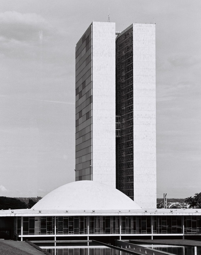 The Brazilian Senate meets under the stately National Congress dome, one of Niemeyer's most admired monuments. The two slender towers are filled with offices.