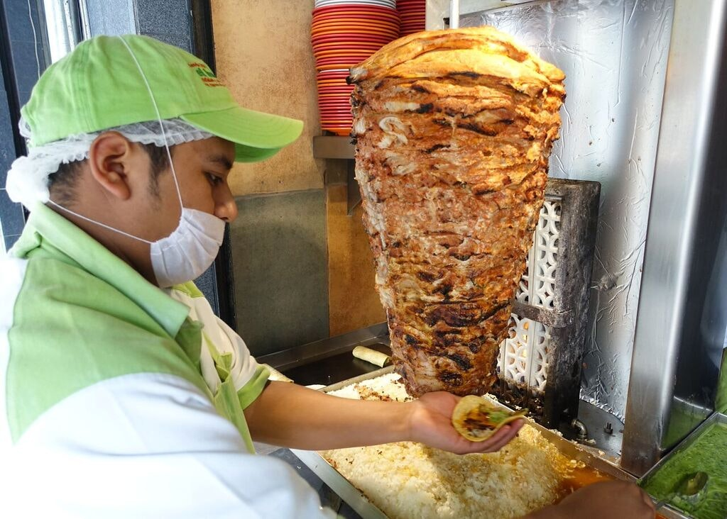 The spit-roasted pork used for tacos al pastor