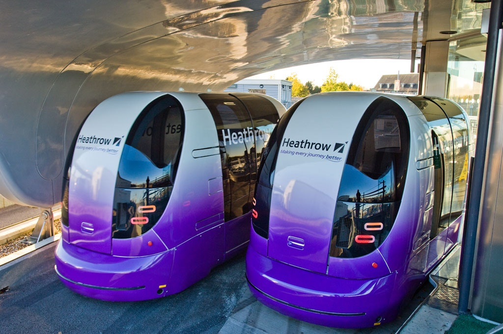 Heathrow's battery-powered pod cars charge up in the station between rides.