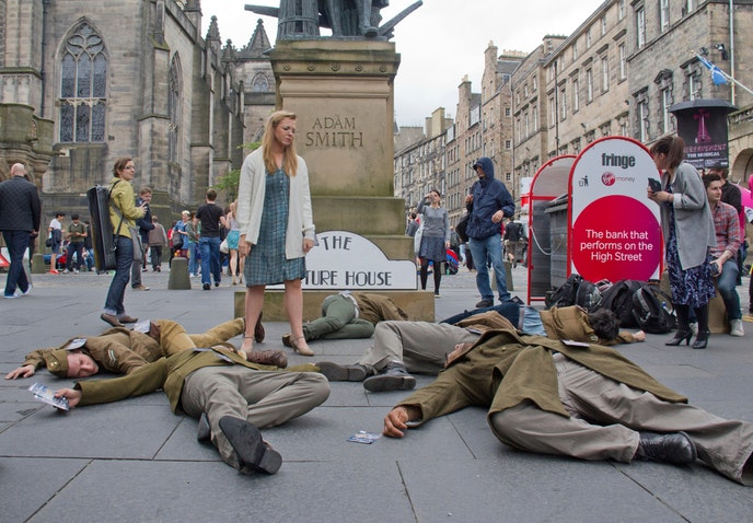 "The 2012 cast of ""The Picture House"" play dead on the Royal Mile."