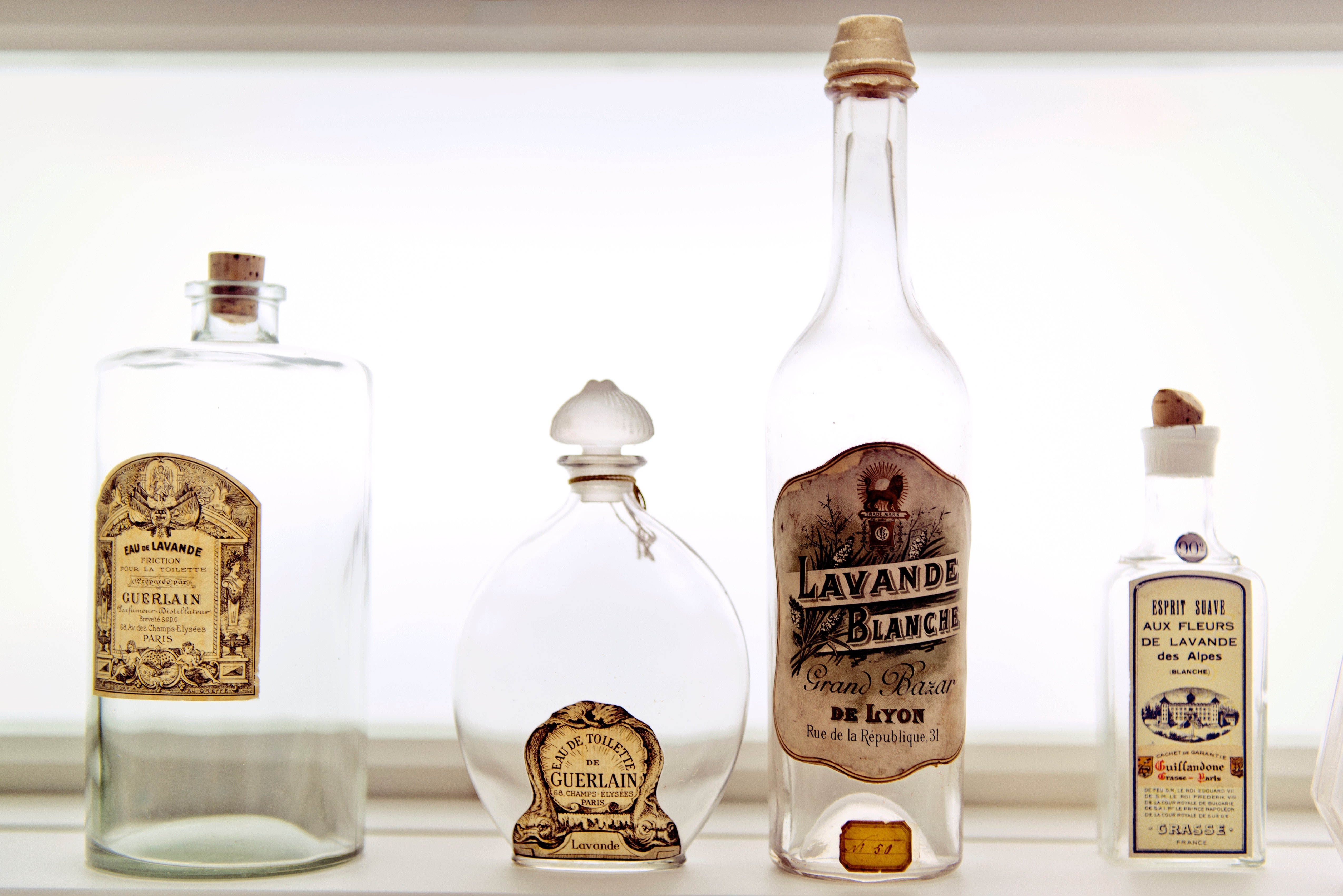 Antique bottles at the Musée International de la Parfumerie in Grasse represent the city's long tradition of perfume making.