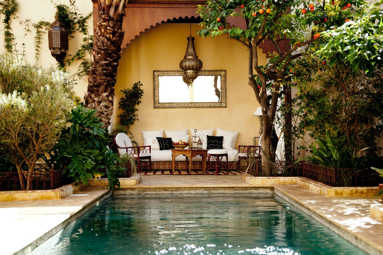 The central courtyards of many riads, such as the Djahane Garden, often feature pools, lounges, and greenery.