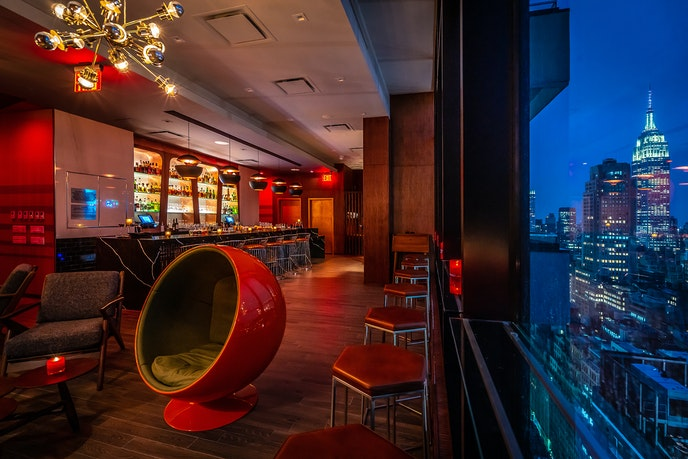 Take in NYC's inimitable skyline from the rooftop of Dear Irving.