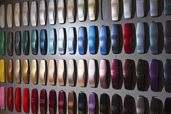 Color swatches in every possible shade are displayed at the Rolls-Royce manufacturing plant.
