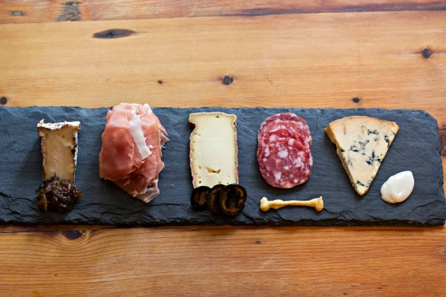 Murray's Cheese Bar serves signature cheese plates with suggested wine, beer, and cider pairings.