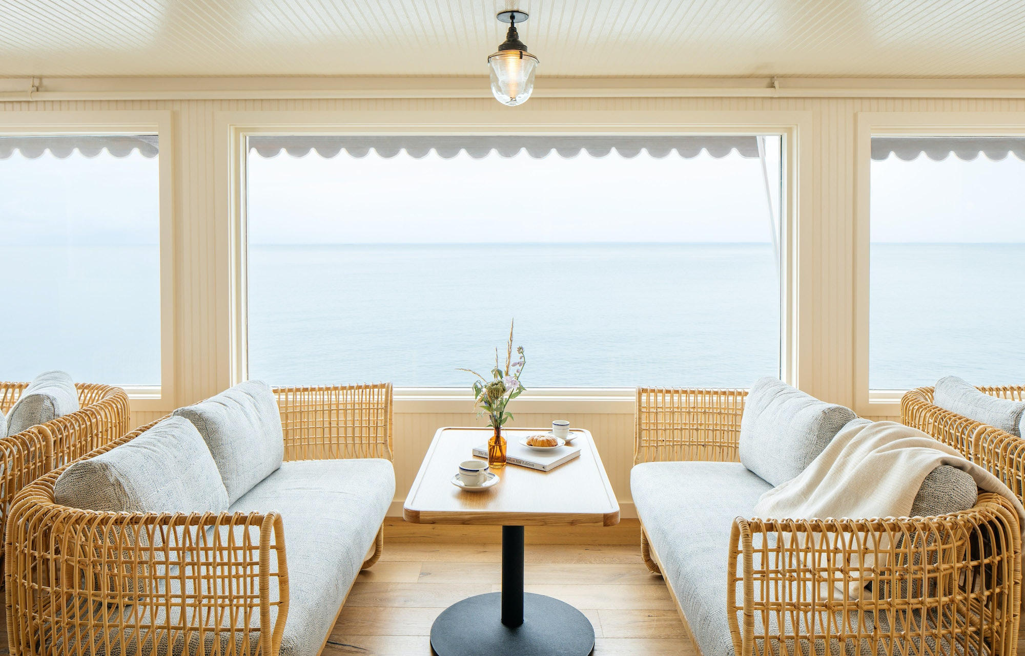 The ocean-facing lobby lounge at Sound View Greenport looks out on the Long Island Sound.