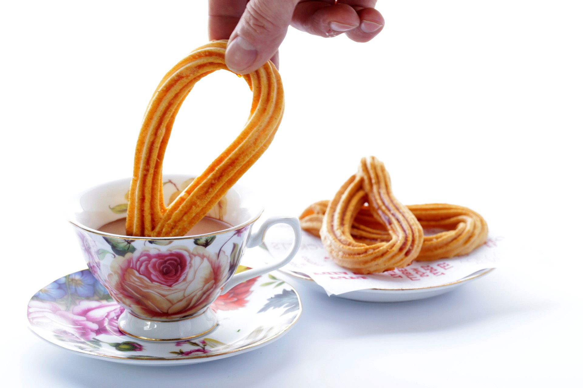 Cakes and Bubbles will serve sweets like these churros con chocolate.