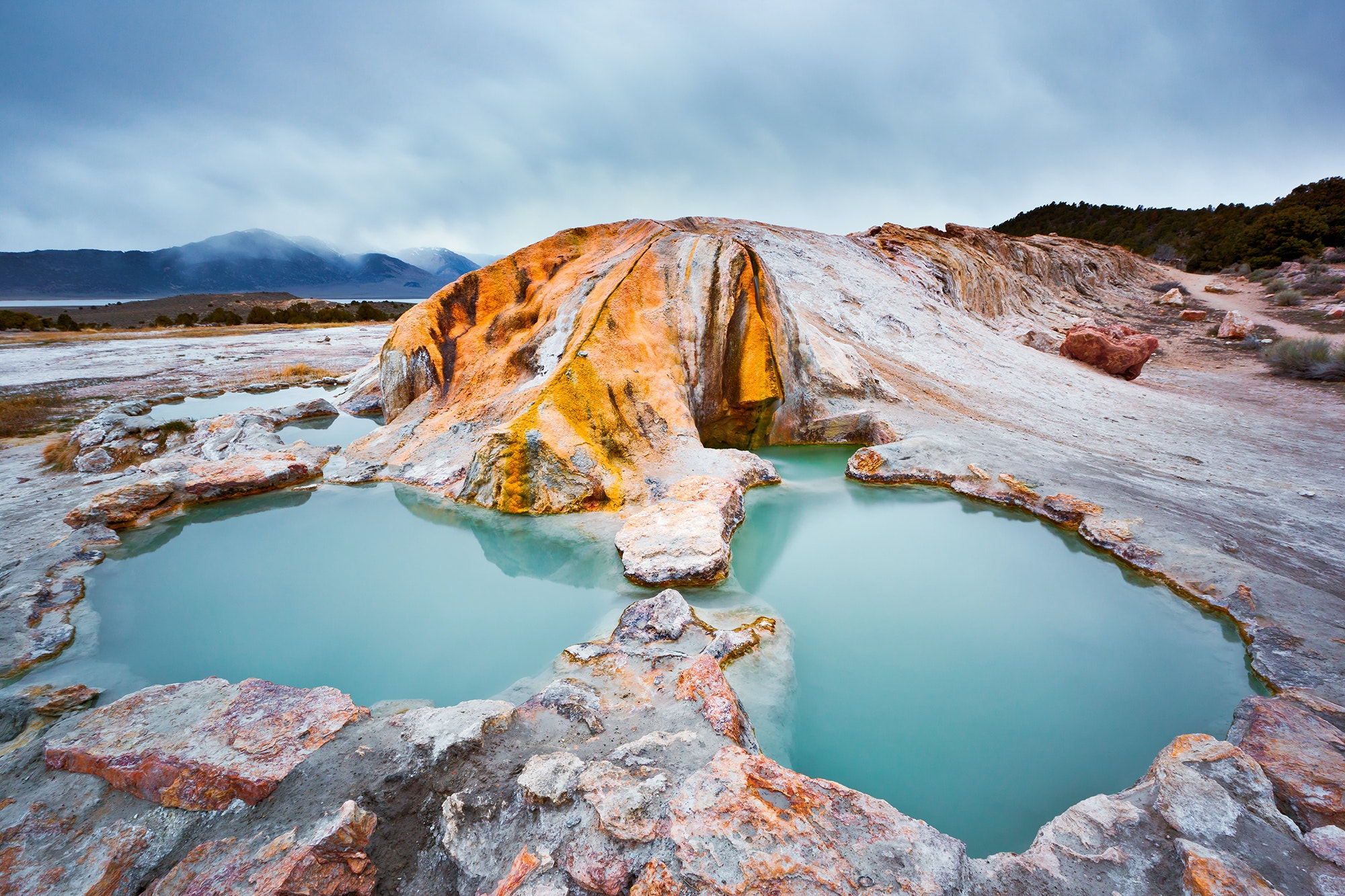 The rocks at Travertine Hot Springs have a streaked patina from the mineral-rich water.