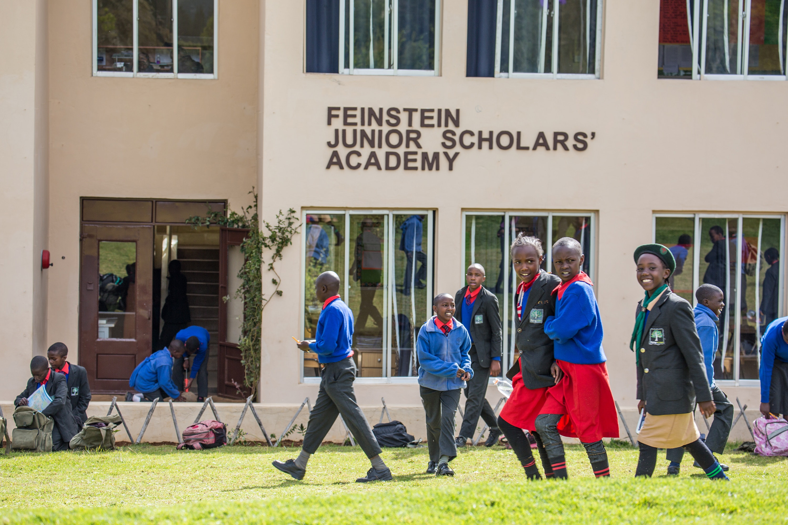 Students at Flying Kites walk in front of the Feinstein Junior Scholars' Academy, the main building on the current campus. Beginning January 2019, a new building will accomodate 70 new students, nearly doubling current enrollment.