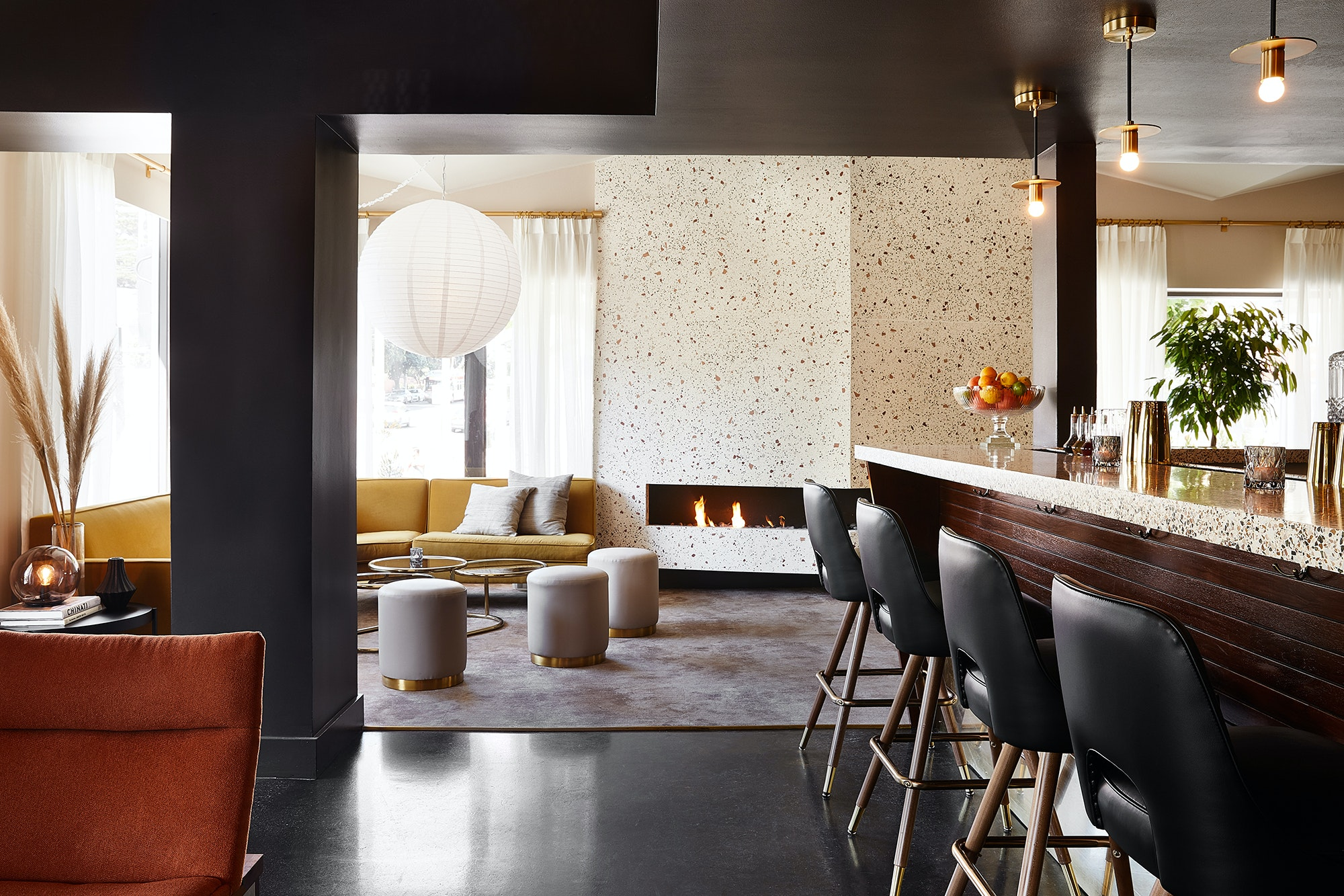 Cozy up in front of the terrazzo fireplace at the newly redone Laureate Bar.