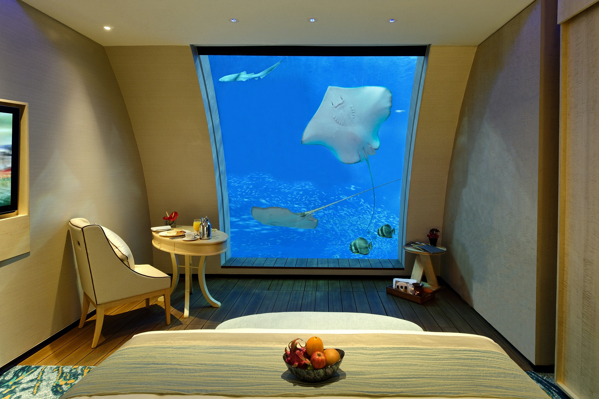 The Ocean Suites at Resorts World Sentosa have sunken bathtubs in front of the viewing window.