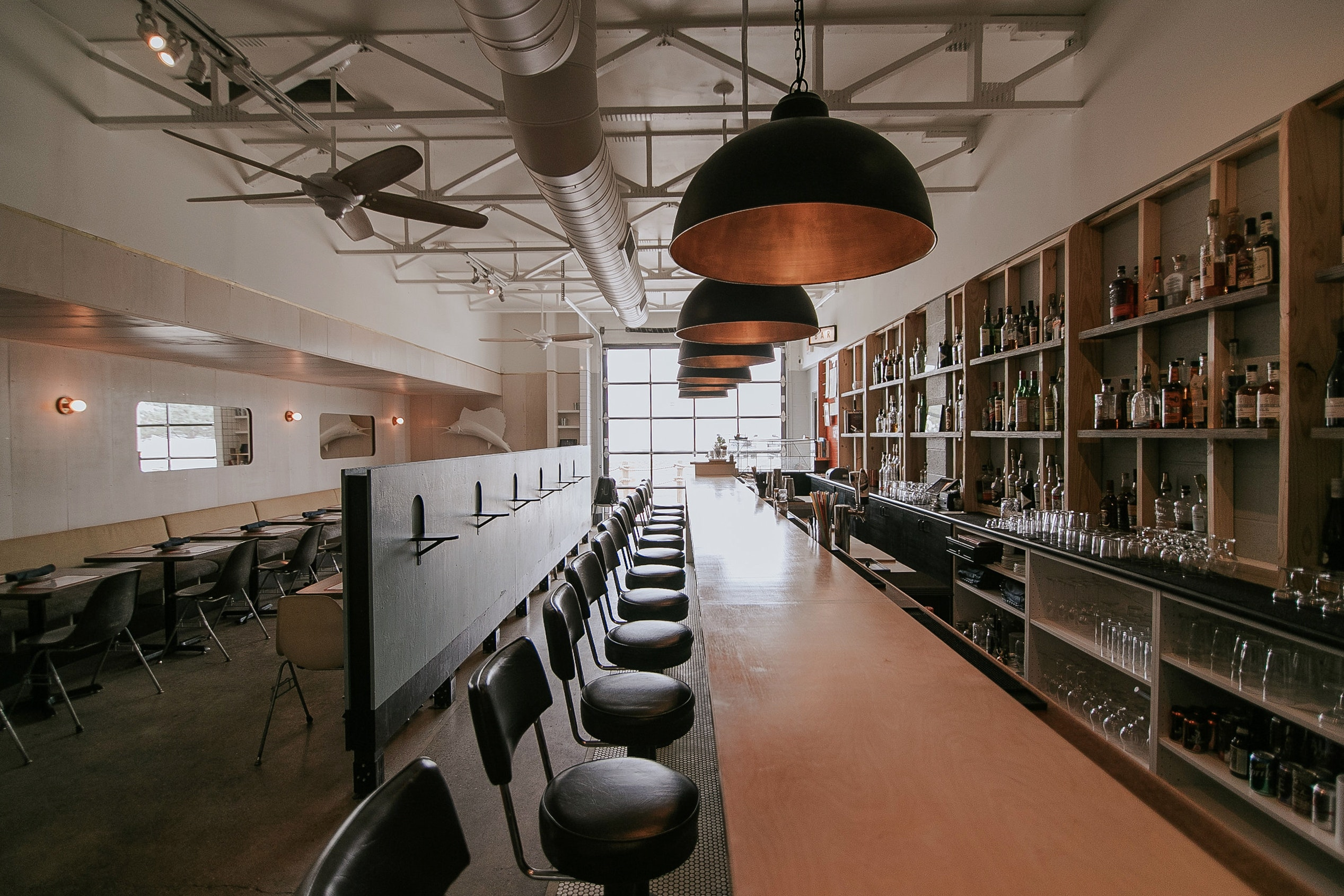 With the help of esteemed design firm five/eighths Architecture, Eli Boyer gave an old garage new life as a seafood restaurant.