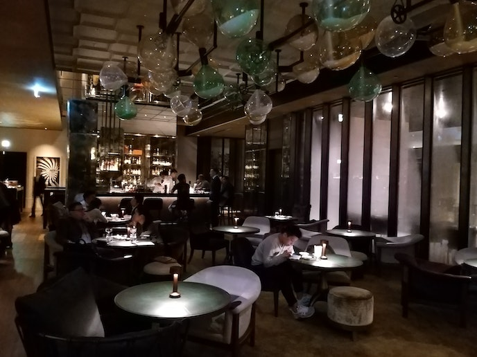 The moody interior of DarkSide features a series of oversize rotating hourglasses; head to the terrace to smoke the bar's vintage cigars.