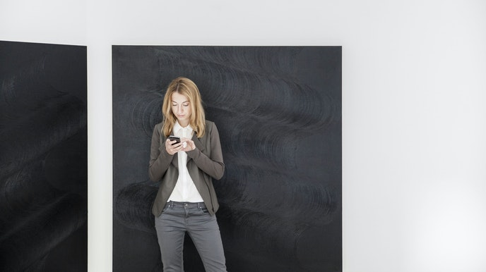 Drdova Gallery founder Lucie Drdova, pictured in front of a painting by Daniel Vlcek.