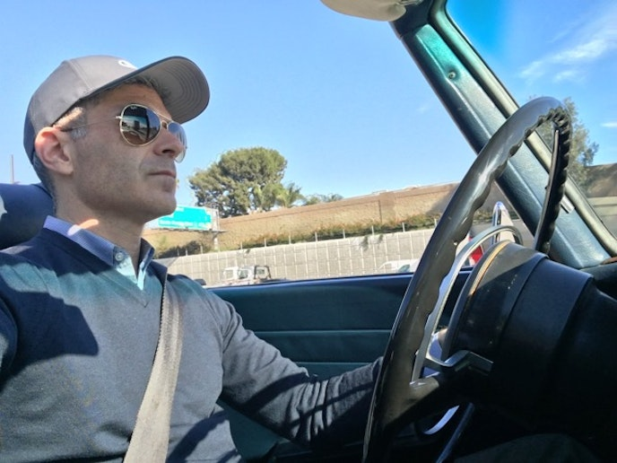 Hollywood glam: The author and his rented vintage Benz.