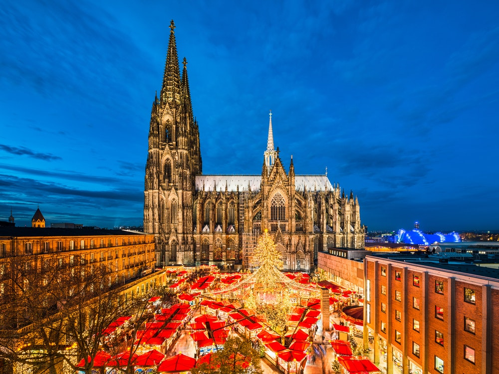 The city's cathedral serves as a dramatic backdrop for Köln's Christmas market.