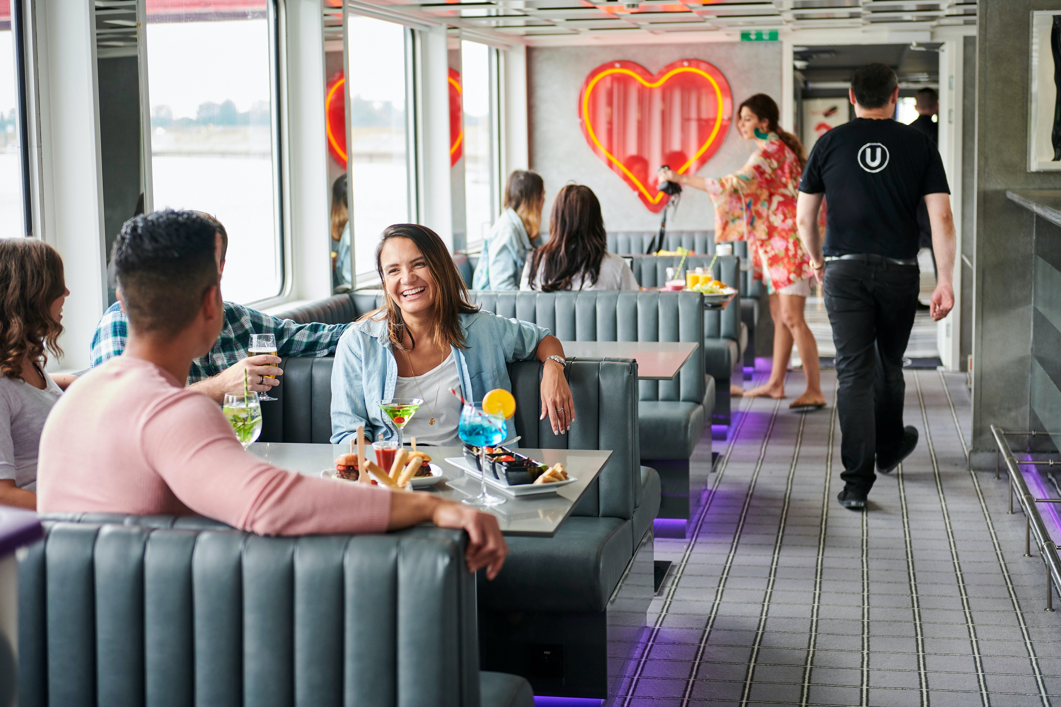 Passengers mingle in the lounge on The A, one of the two adult-only river cruise ships operated by U by Uniworld.