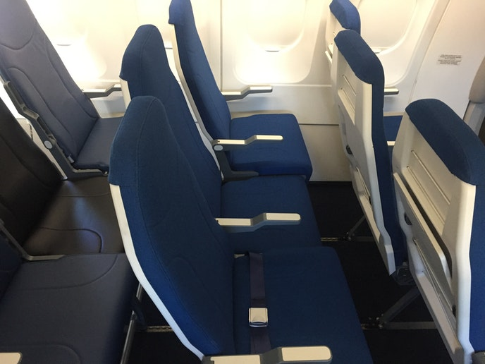 A ramped armrest offers a lower portion of the armrest meant entirely for the middle seat passenger.
