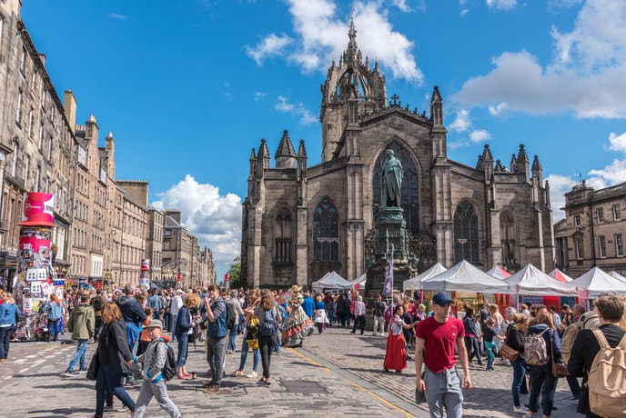 A stroll along the Royal Mile during the Fringe can be crowded—but you might see a surprising performance.