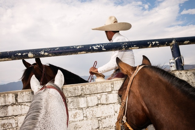 Charros and horses go for a ride at the Lienzo Charro of Tlalixtac de Cabrera, Oaxaca.