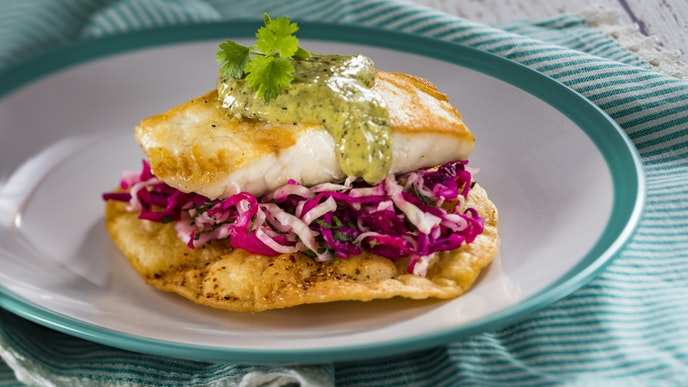 Find the Pacifico True Striped Bass Tostada among the global marketplace kitchens at Coastal Eats.