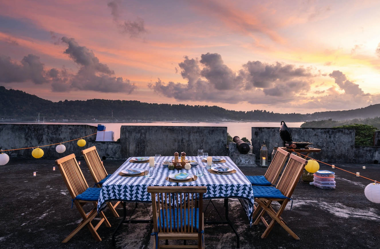 A twilight dinner set up by the Rascal crew on the island of Banda Neira