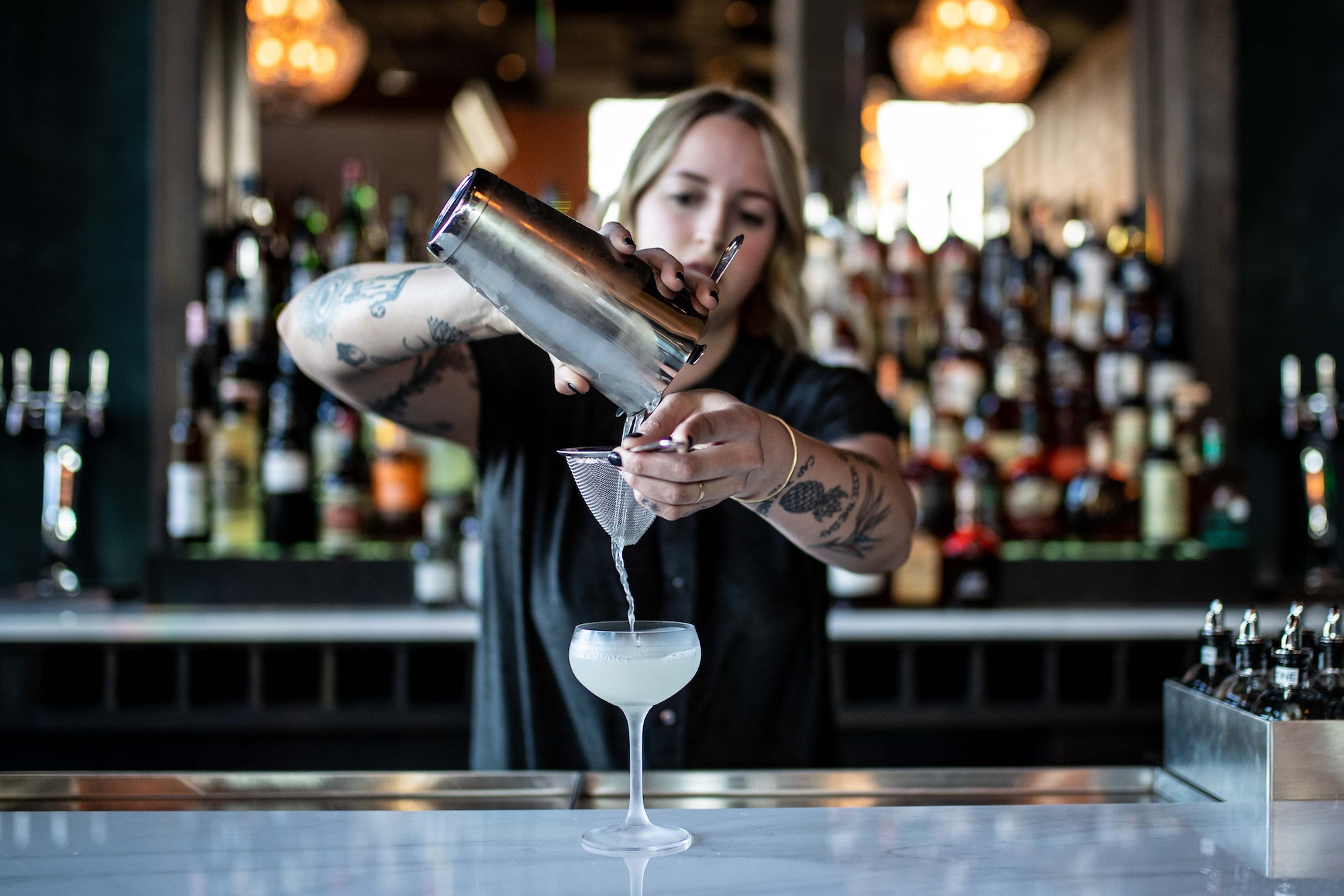 "Bar manager, Alex Jump, mixes the ""Surf's Up,"" with 3 Island Rum, Rum Agricole, and Pineapple Cordial off the ""Light and Playful"" menu section."