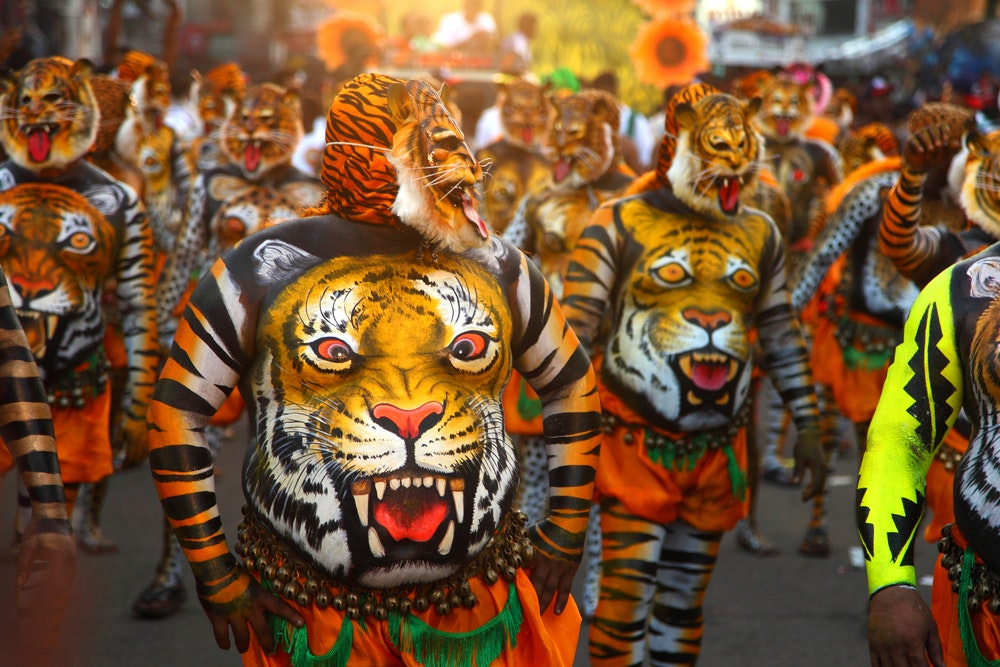 Men painted for the tiger dance during the Onam festival
