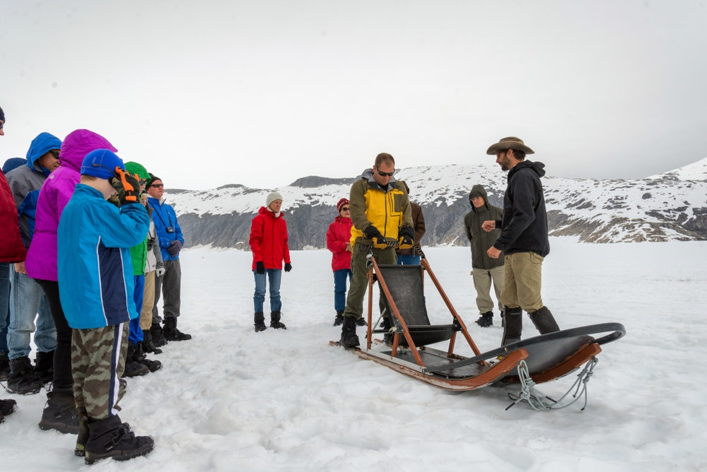 A tour group prepares for a dog sledding outing on the Norris Glacier in Alaska.