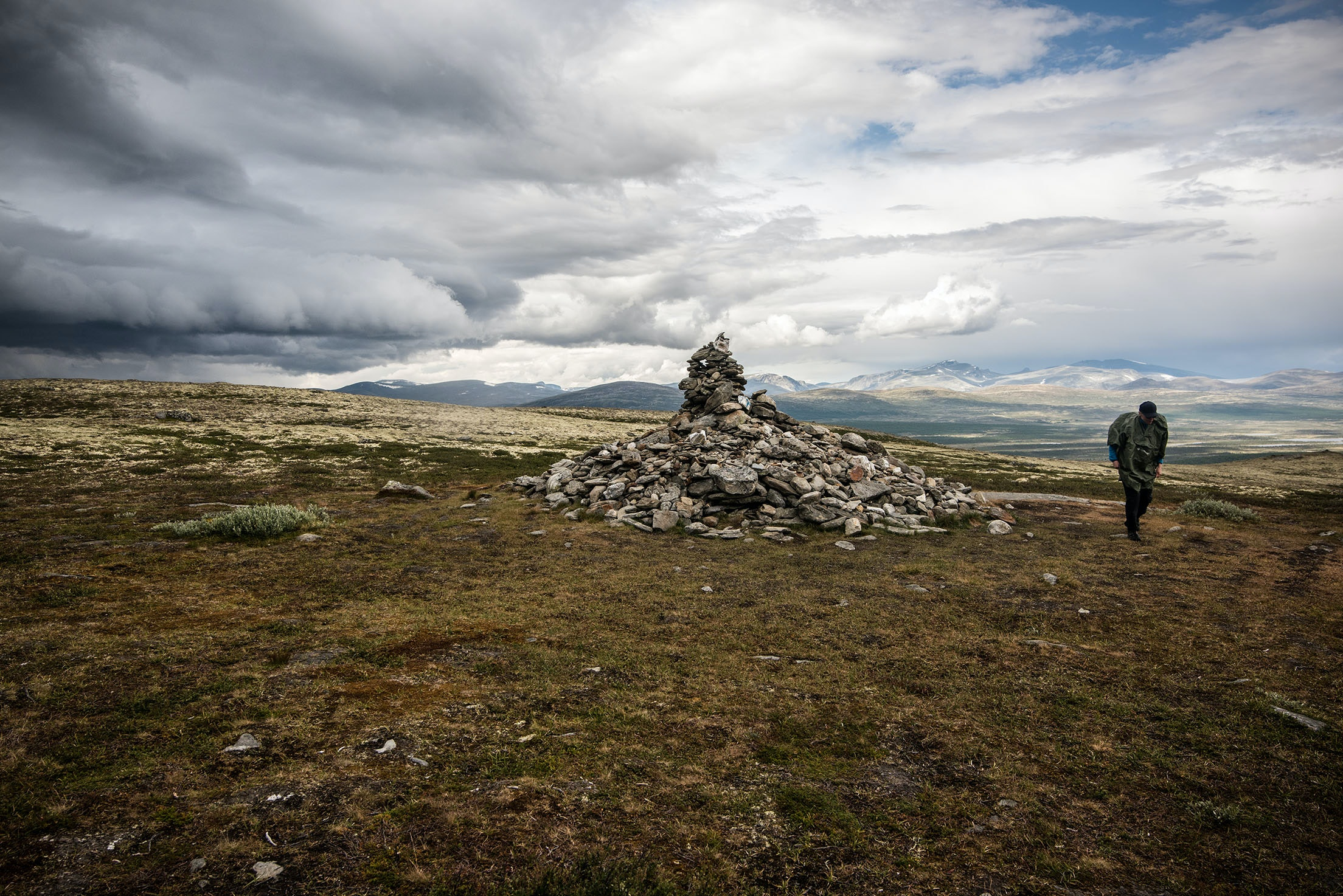 Set an intention of self-improvement at the 10-foot cairn in Dovrefjell National Park by adding a stone.