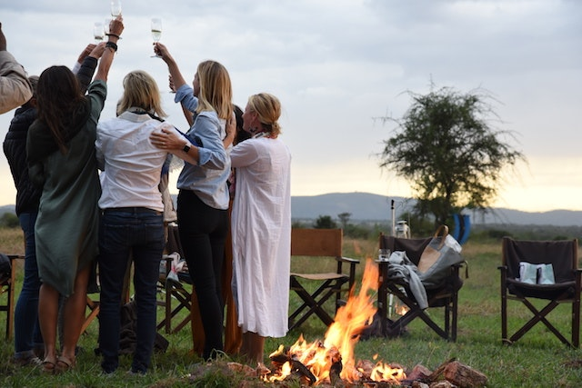 The women from the first annual Serengeti Girls Run share a post-event toast at Singita Explore