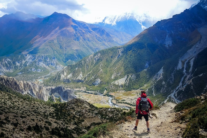 Nepal is a landlocked country bordered by India and China, and enveloped by the record-breaking Himalayan mountain range.