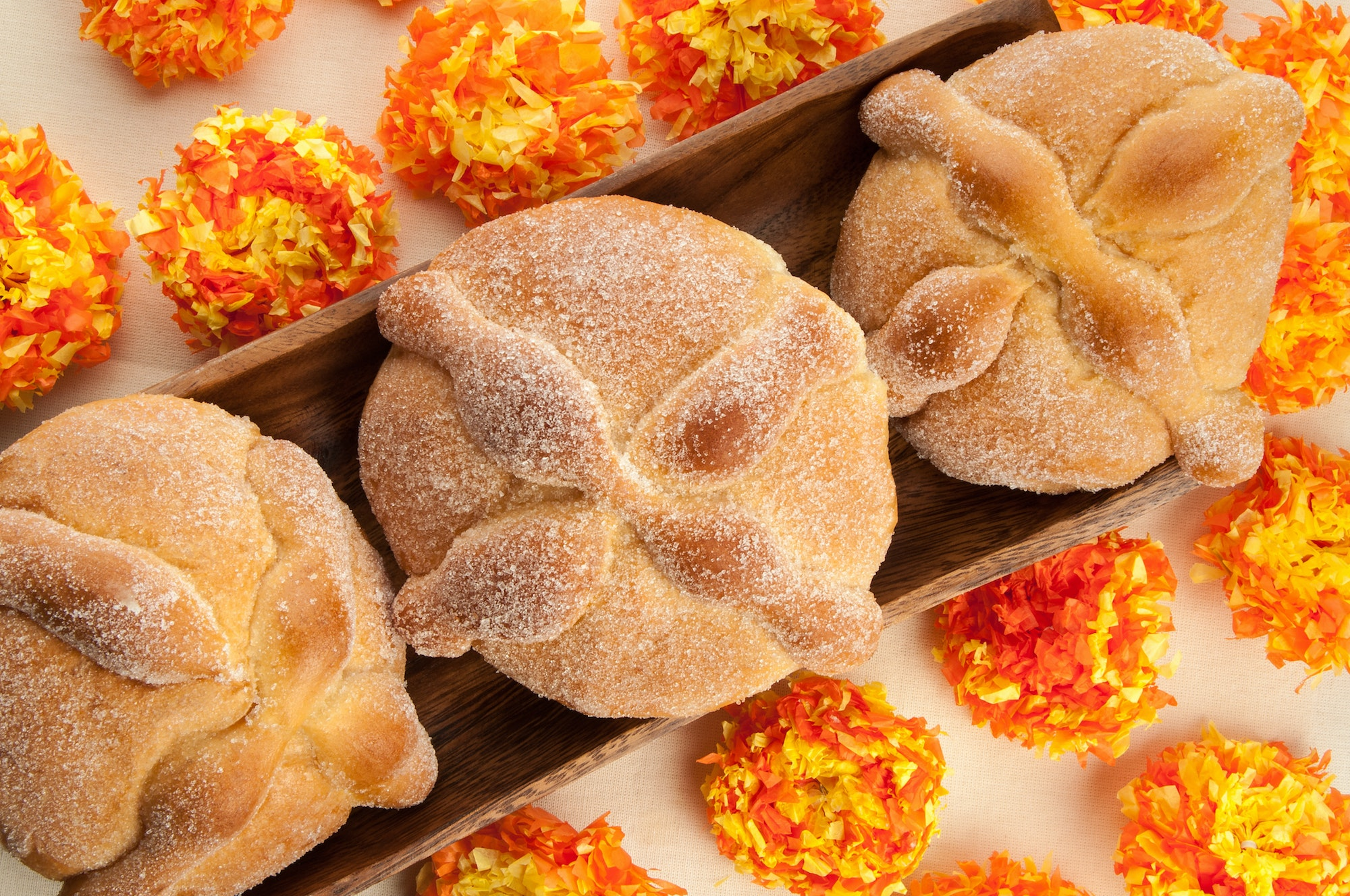 """Pan de muertos"" is a traditional treat associated with Día de los Muertos in Mexico."