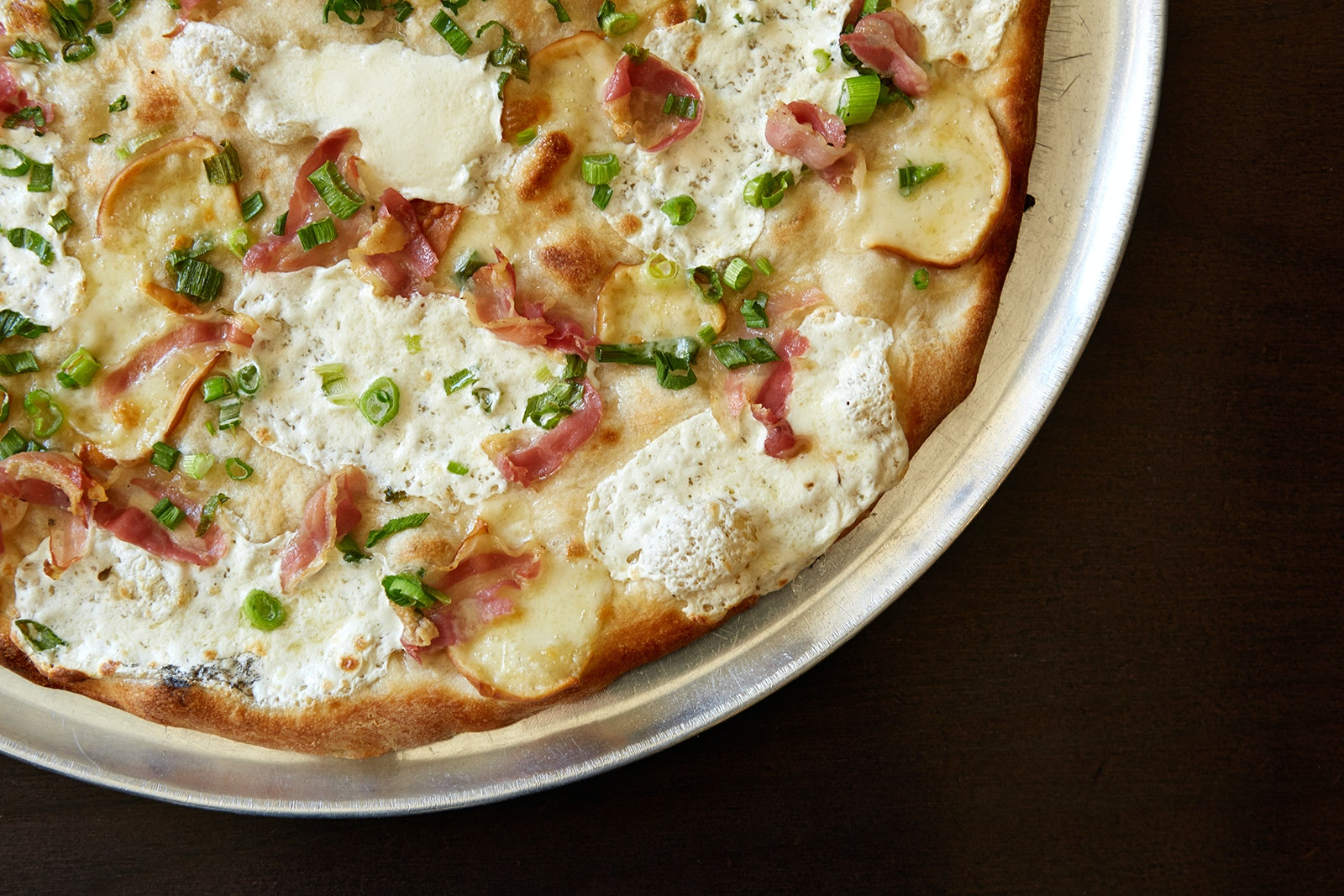 Steps from the Brooklyn Bridge, Patsy Grimaldi serves pies from the restaurant's original coal-fired oven at Juliana's.