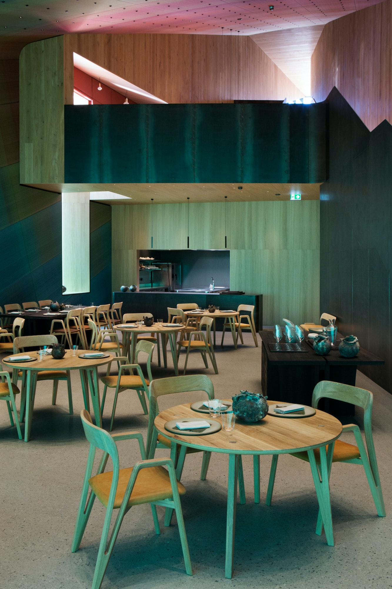 Inside the monolithic structure, the decor creates an ocean-inspired environment.