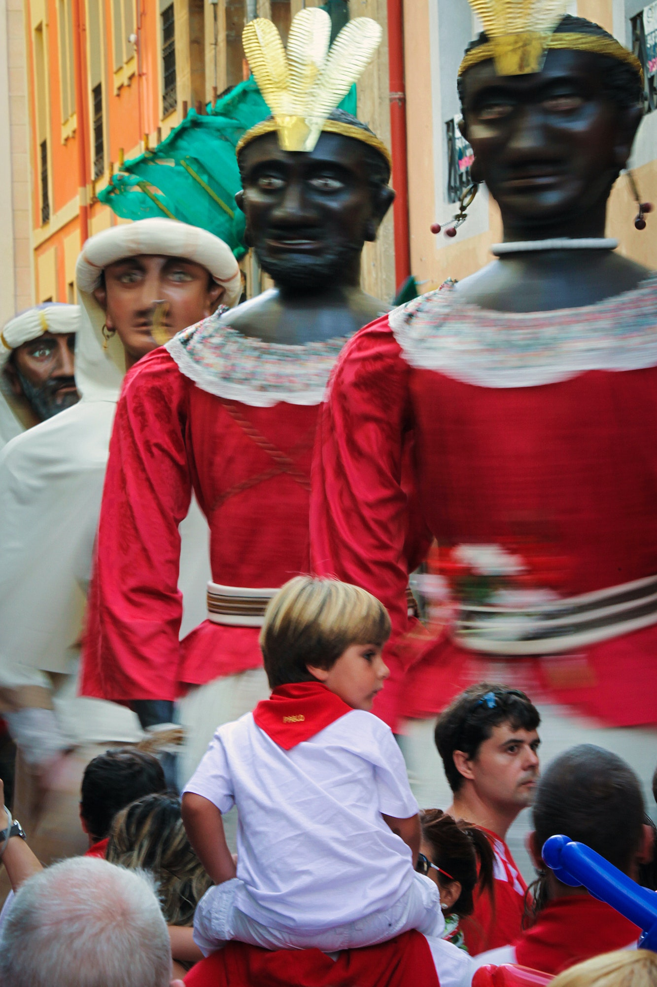 The Giants and Big Heads parade comprises papier-mâché figures that resemble mythical kings and queens.