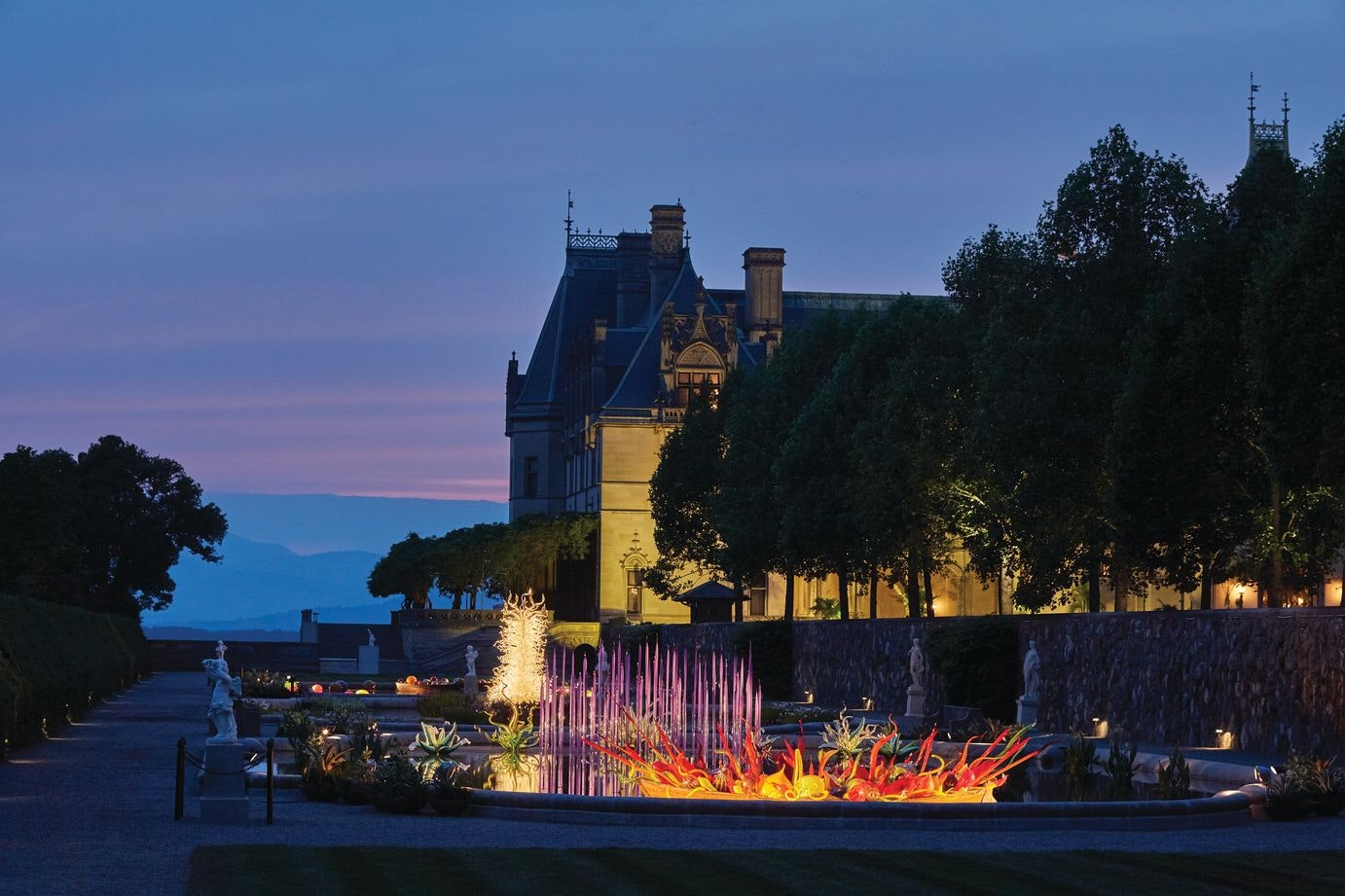 On selected evenings, the Biltmore Estate turns on the lights for Chihuly Nights.