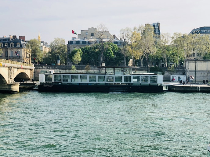 Fluctuart is located adjacent to the Invalides Bridge.