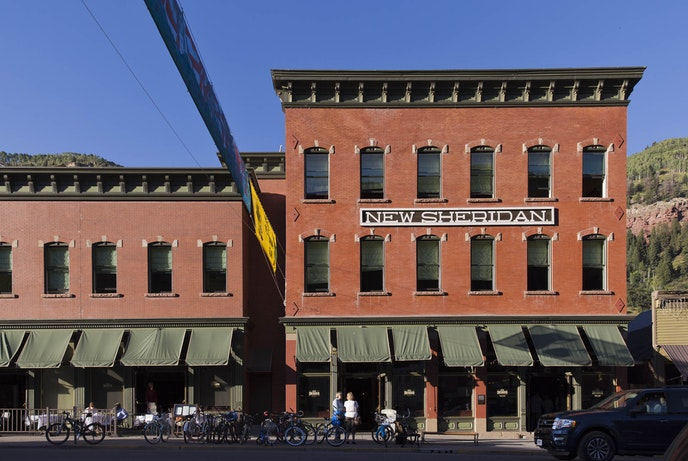 The Hotel New Sheridan features a rooftop bar with views of downtown Telluride.