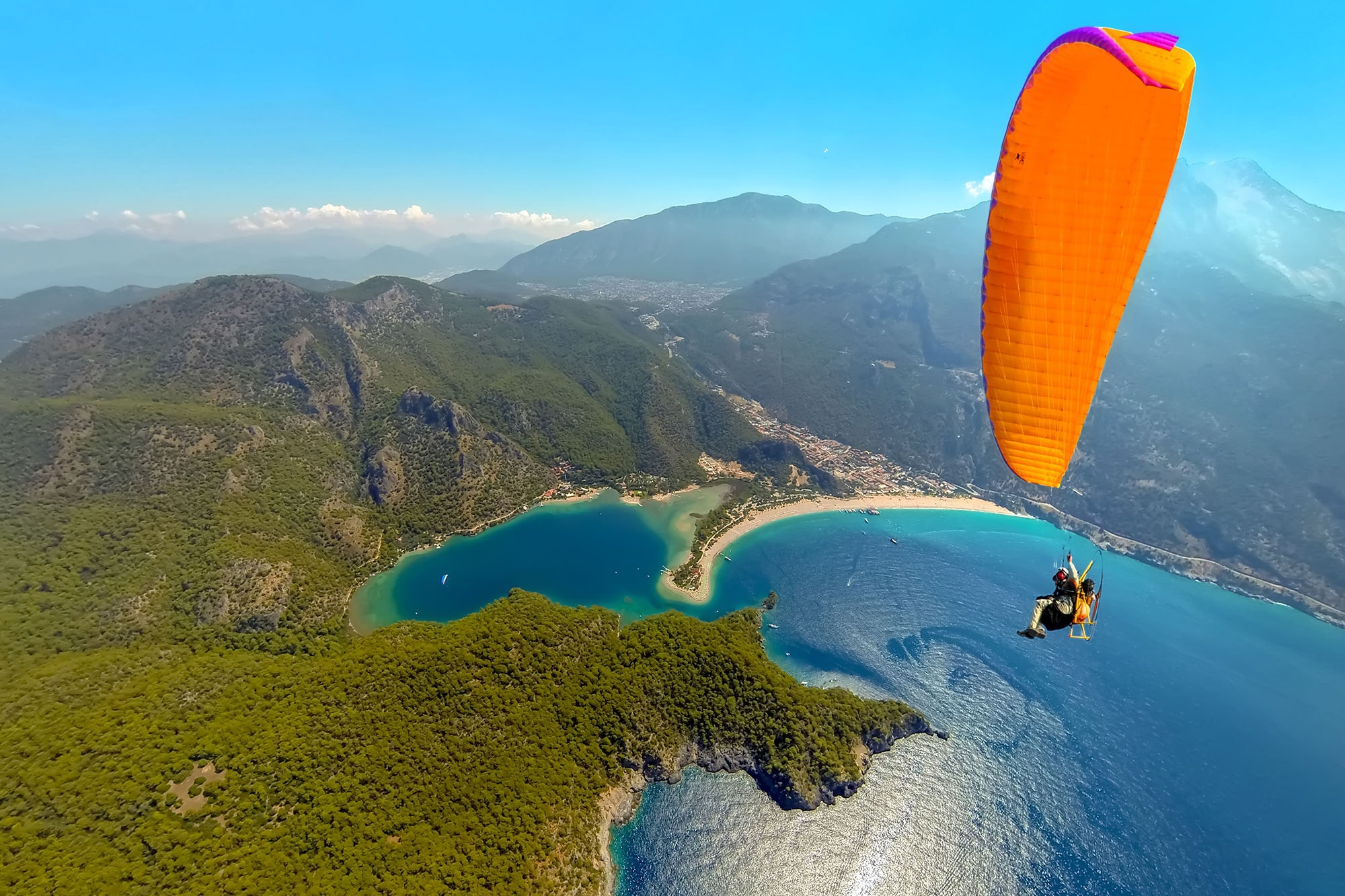 Take in Turkey's gorgeous Blue Lagoon while paragliding.