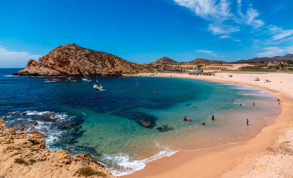 Snorkel or just lounge on the sand at Santa Maria Beach by Cabo San Lucas.