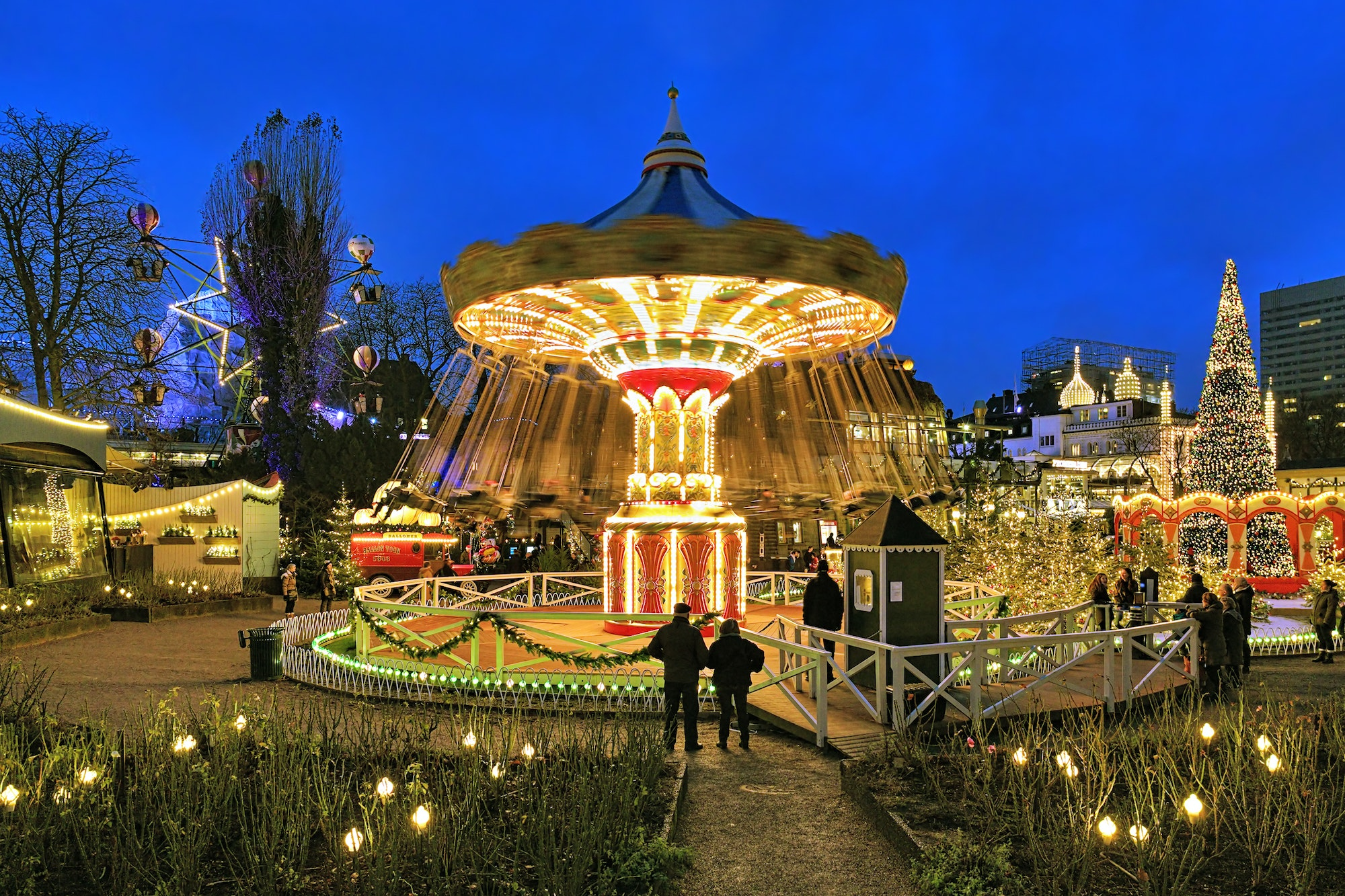 During the holidays, Copenhagen's Tivoli Gardens are decorated with bright lights and Christmas trees.