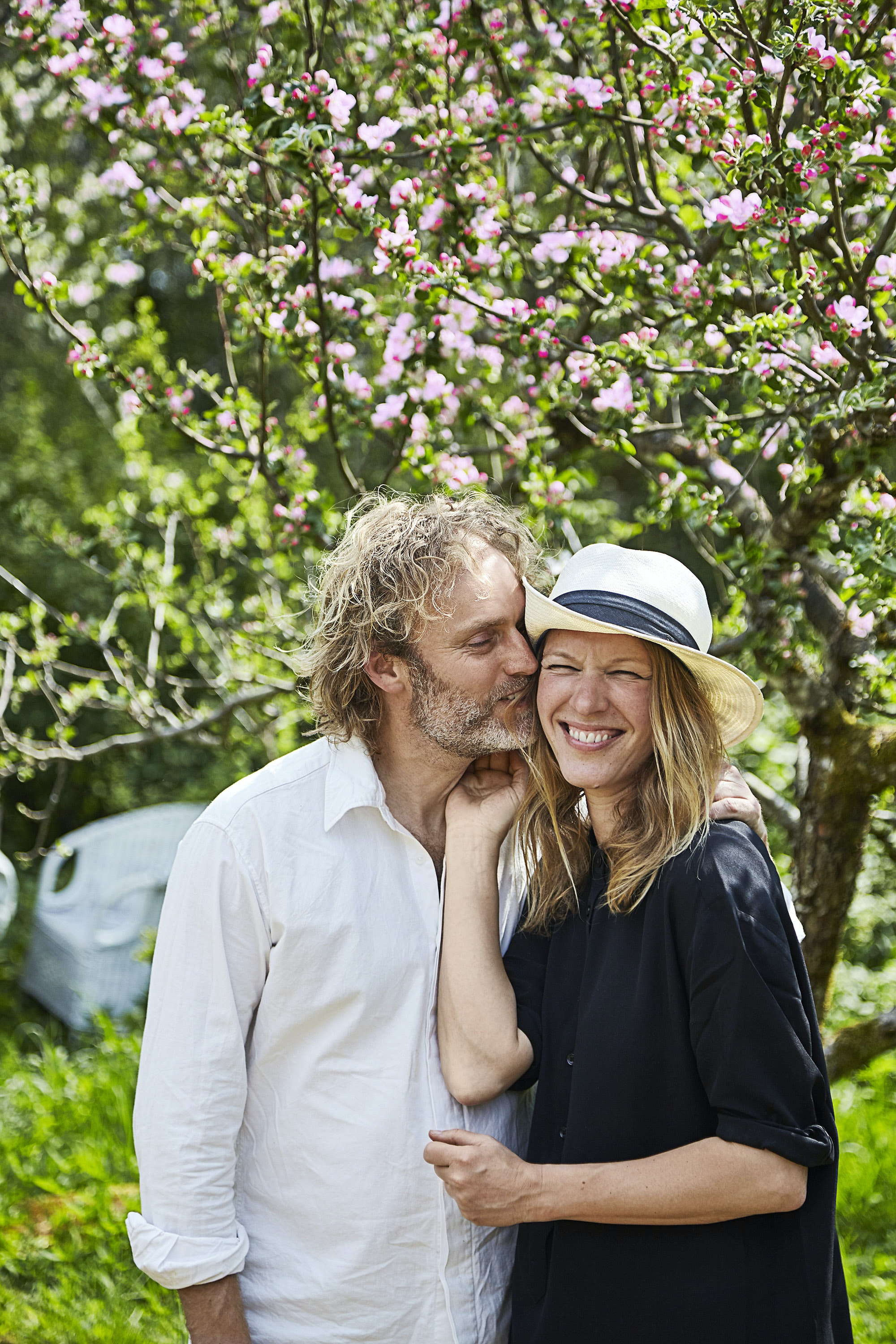 Flemming Hansen and Mette Helbæk serve food raised on their permaculture farm to guests.