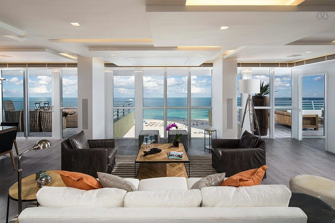 Stay in the heart of the South Beach scene at this posh penthouse unit overlooking the beach.