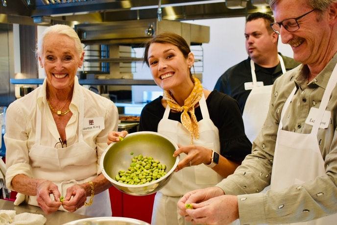 Students at the new Biale cooking class show off fava beans, an ingredient for one of the recipes they learned for the day at CIA Copia.