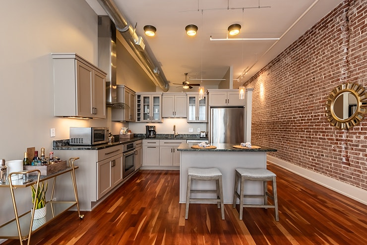 Need a full kitchen and room to entertain? Check into the Restoration.