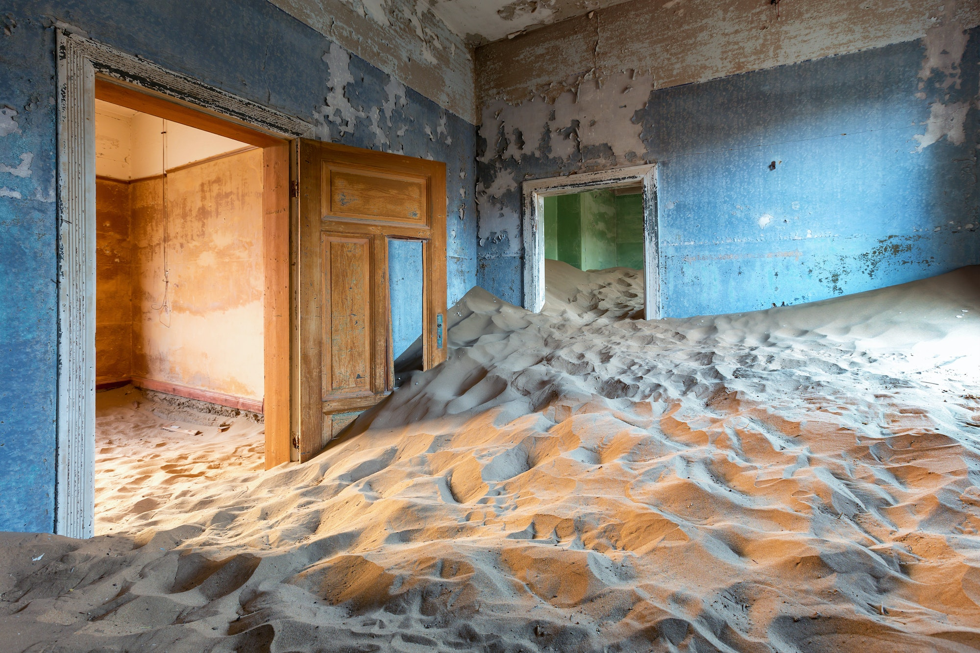 The dilapidated buildings that once housed German settlers have since been reclaimed by Namibia's desert sands.