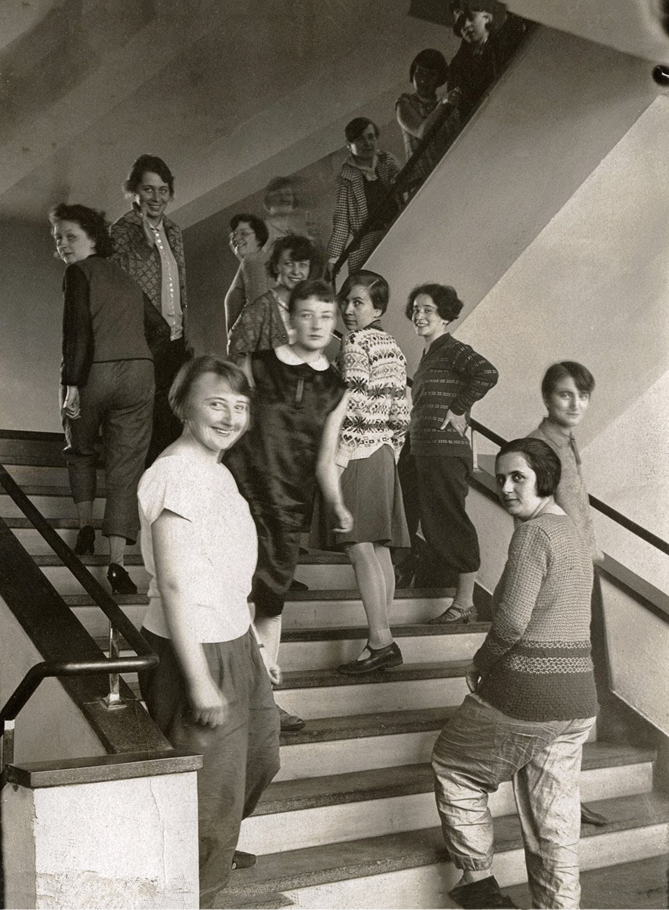 A group of weaving students on the Bauhaus stairs in Dessau, c. 1927